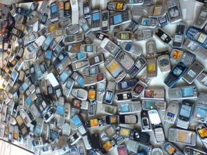 This image of a table full of outdated cell phones is brought to you by Octa, creators of the Whale Kit iPad stand.